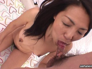 Mature Asian slut sucks as the young one mast