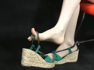 Asian feet showing in wedge espadrille fashion sandals. Zoom.