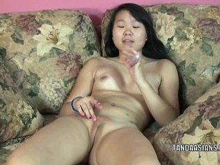 Shy coed Jaylynn stuffs a toy in her hot Asian twat
