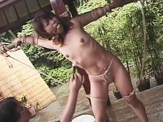 Japanese woman tied and restrained with dildo